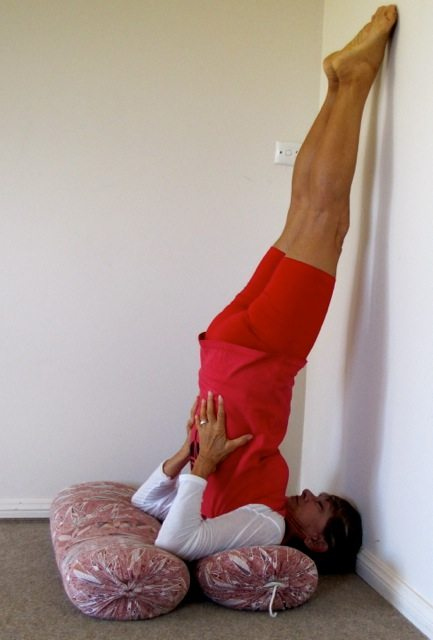 An image of a person in a yoga pose, Salamba Sarvangasana, shoulderstand