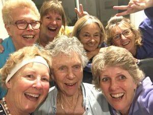 A selfie of 7 smiling women.