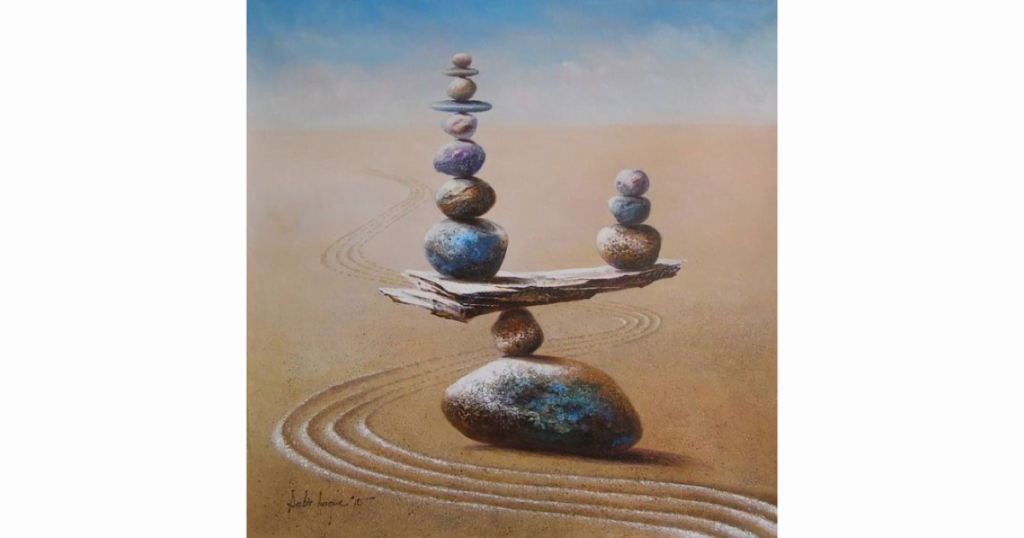 An image of cairns, rocks balancing on each other.
