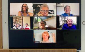 A computer screen showing a split view of eight women.
